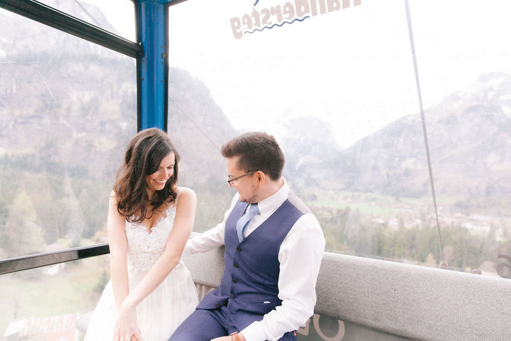 Wedding couple travelling in cable car