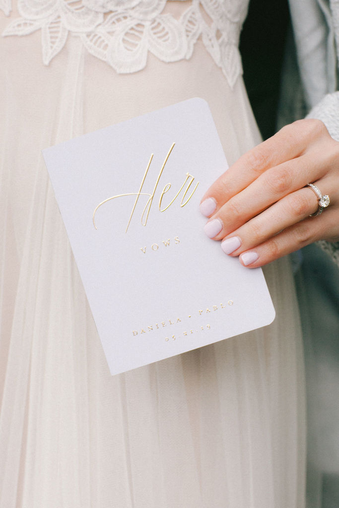 A bride holding her vow book