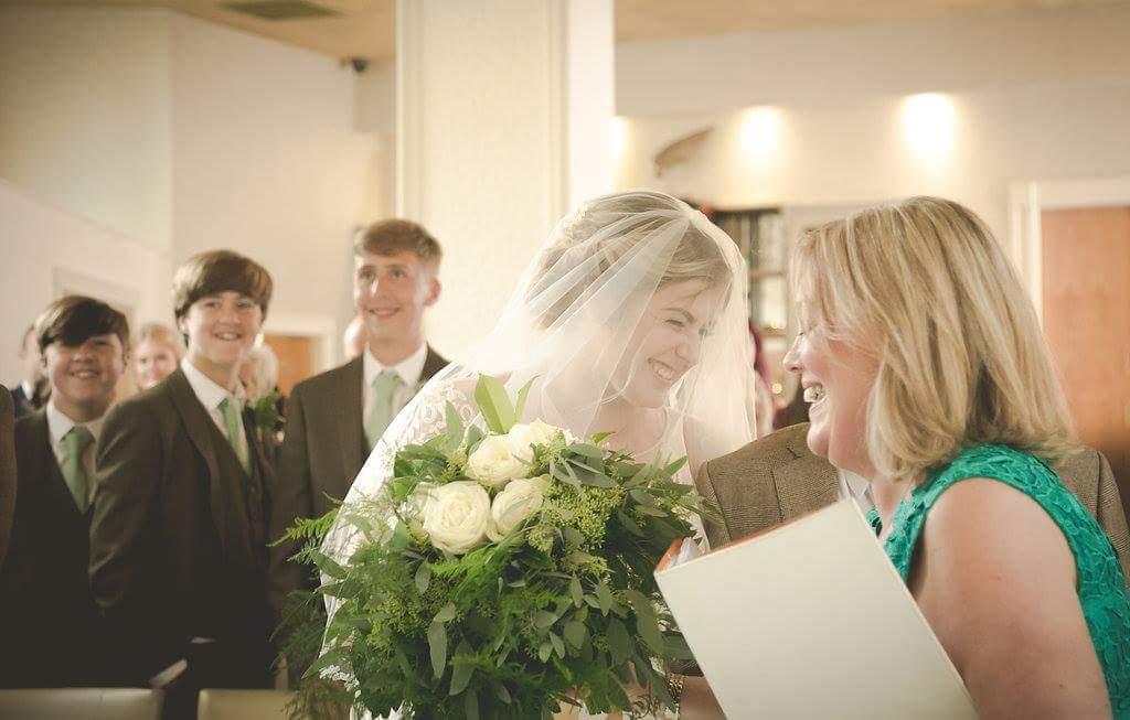 A wedding celebrant leading a ceremony
