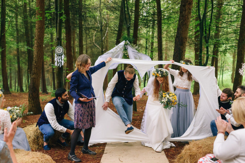 Couple getting married in the woods